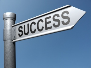success sign post