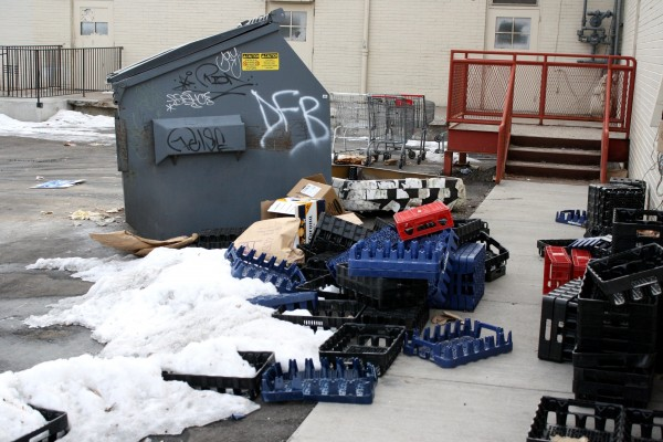 dumpster-with-boxes-and-plastic-crates-600x400